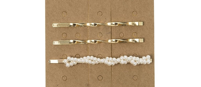 Pack of 3 Hairpins with faux pearls. This trending Pearl Hairpin is the perfect accessory to elevate any outfit!  Made from a golden hairpin