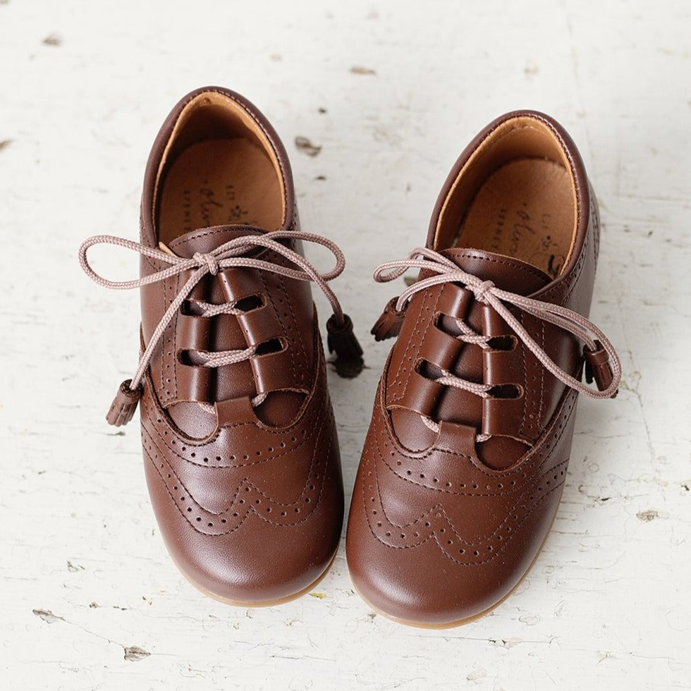 Beautiful smart-casual style lace-up brogue shoes. Made in an classic tan leather with contrast cream laces and a lovely tassel detail. Olivia Ann Shoes