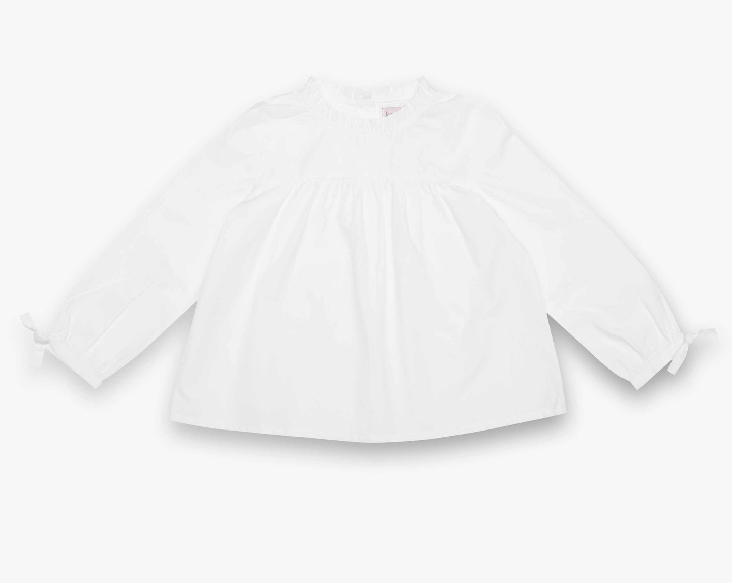 A twist of the Classic White Shirt. This lovely blouse has been designed with sophisticated ruffle around the neckline. Button fastening at the back.