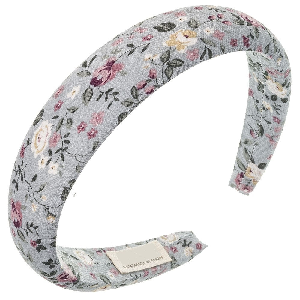 Lovely floral padded hairband. Beautifully handmade in Spain with extreme attention to detail. Suitable for girls or woman! Width 3 cm. Stunning and delicate floral print in a light blue fabric will add the final touch to any outfit! Olivia Ann