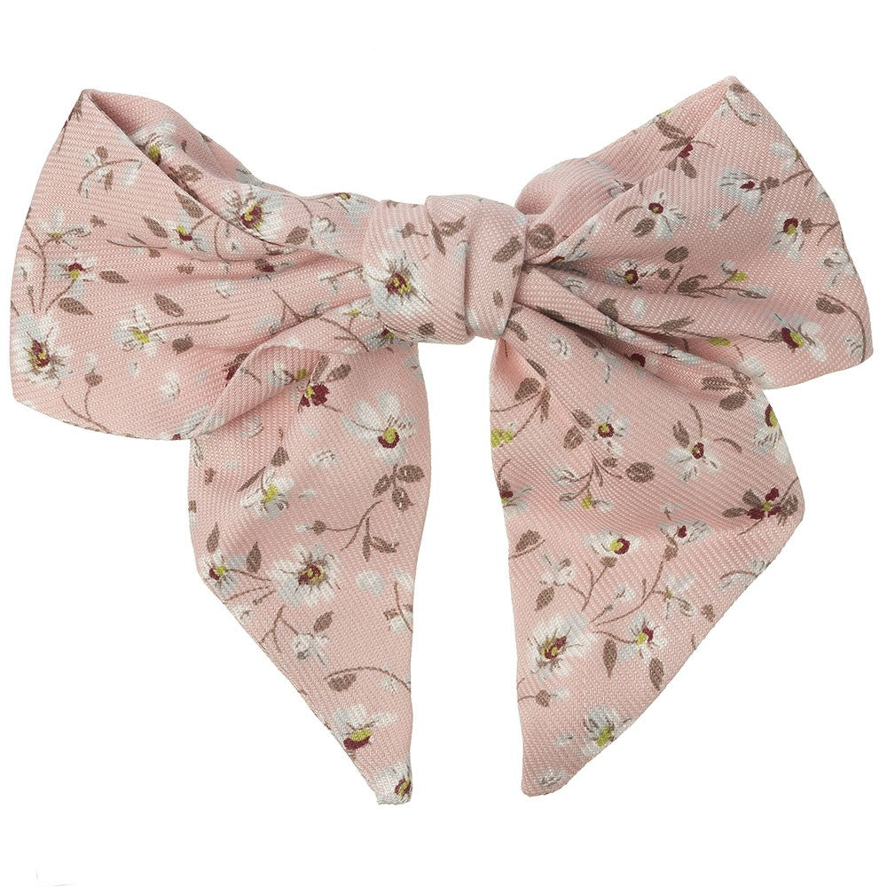 Beautiful hair bow in a delicate pale pink floral pattern, a unique handmade piece! snap hair clip. This bow adds a perfect touch to any outfit!