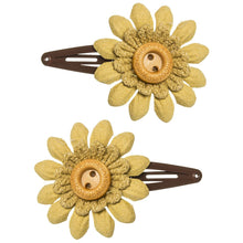 Beautiful and delicate leather flower with a sweet wooden button in mustard colour. Will add a sweet touch to any outfit!