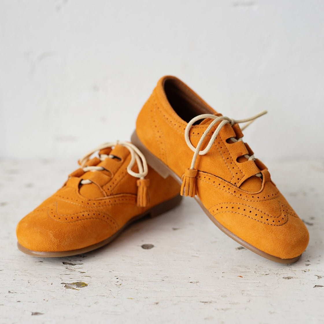 Beautiful smart-casual style lace-up brogue shoes. Made with an adorable mustard colour suede with contrast cream laces and a lovely tassel detail. Olivia Ann Shoes.