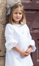 Stunning White Cotton dress. French sleeves puffed from elbow down. Featuring mother-of-the-pearl buttons at the front. Fully lined. A really special piece!