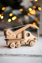 This gorgeous heirloom Wooden Crane is a must-have for any construction site lover.  Its clever design lets your child lift and lower construction materials, heavy pallets and boxes. Just like a real mobile construction crane.