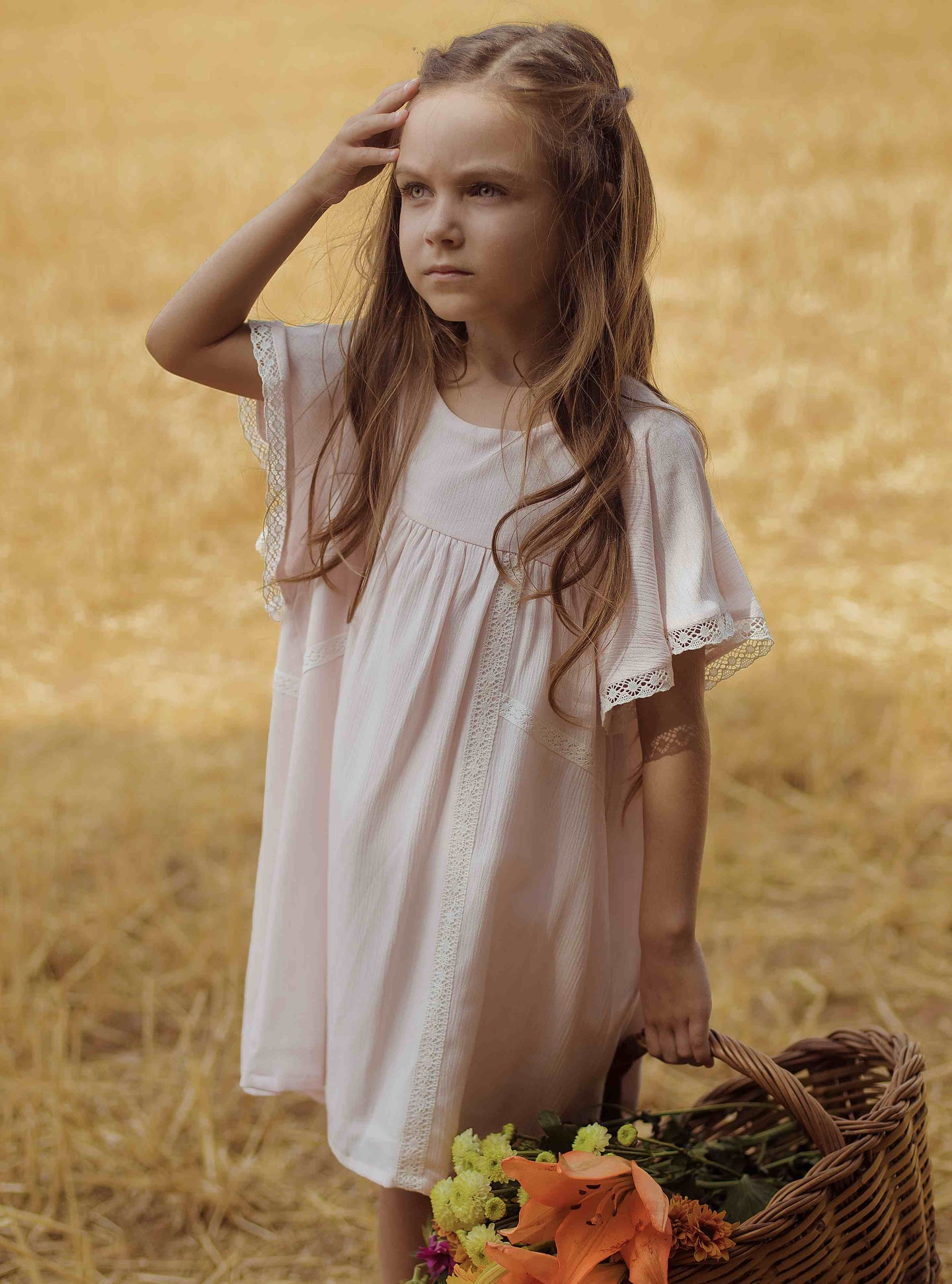 Beautiful vintage inspired dress in a delicate blush pink gauze fabric. Ruffled sleeves and lace cotton details.