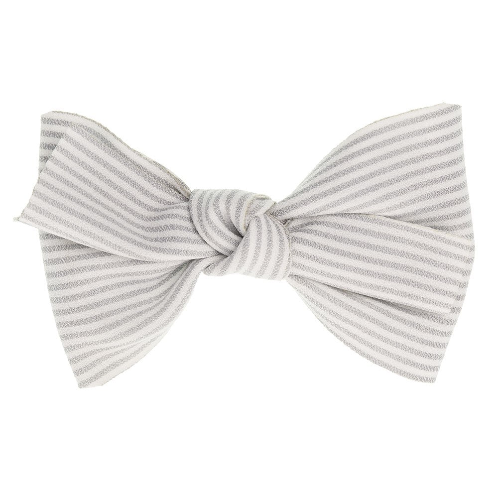 Beautiful hair bow in a delicate light grey cotton stripes pattern, a unique handmade piece! Approximately 11.5 x 9 cm long and secured to 5.5 cm snap hair clip.