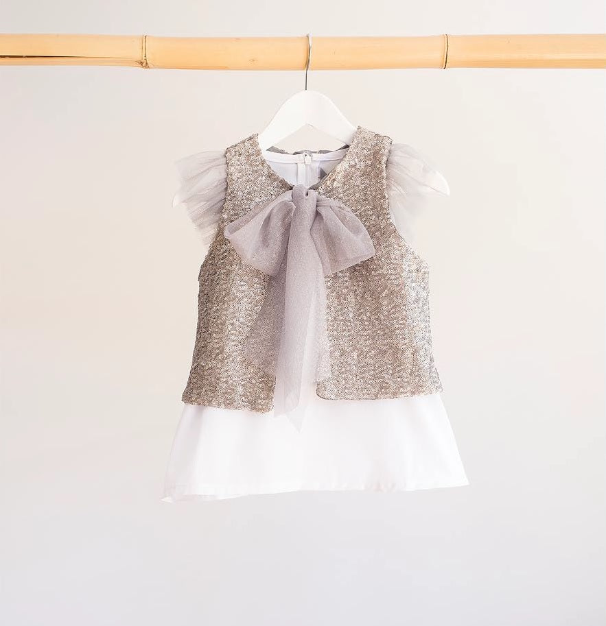 Stunning Sequins Vest! High Quality Silver sequins for a special occasion. Featuring tulle bow to tie at the front. Will add a pop for any outfit!