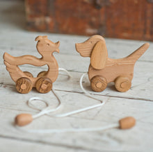 A walk-a long toy is the best toy for those who have already learned to walk. Is comfortable to hold by the smooth wooden handle. The ears are spinning. This sweet beagle is made of solid beech. Montessori educational toy,