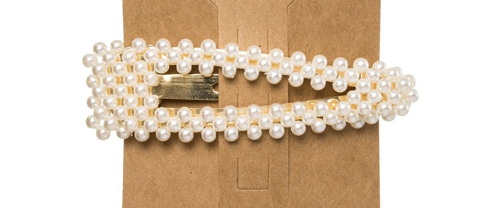 This trending Pearl Hair Clip is the perfect accessory to elevate any outfit!  Made from a metal base, it is delicately detailed with faux pearls.  Designed with a snap closure, these Pearl Hair Clips