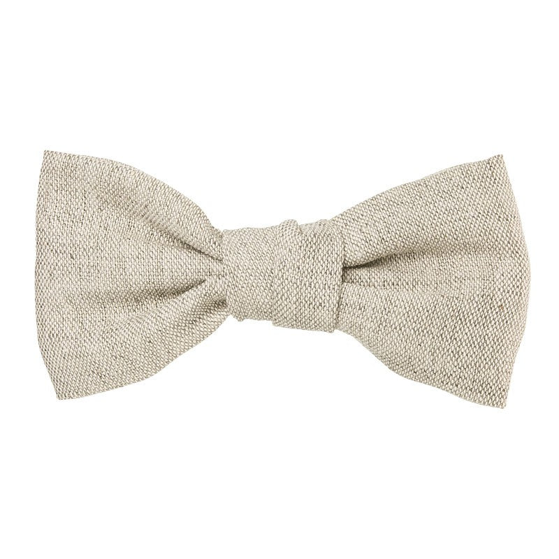 Beautiful and classic Linen bow in an alligator hair clip. This bow adds a perfect touch to any outfit! Timeless design a must have!. Handmade in Spain. Olivia Ann Wholesale accessories.