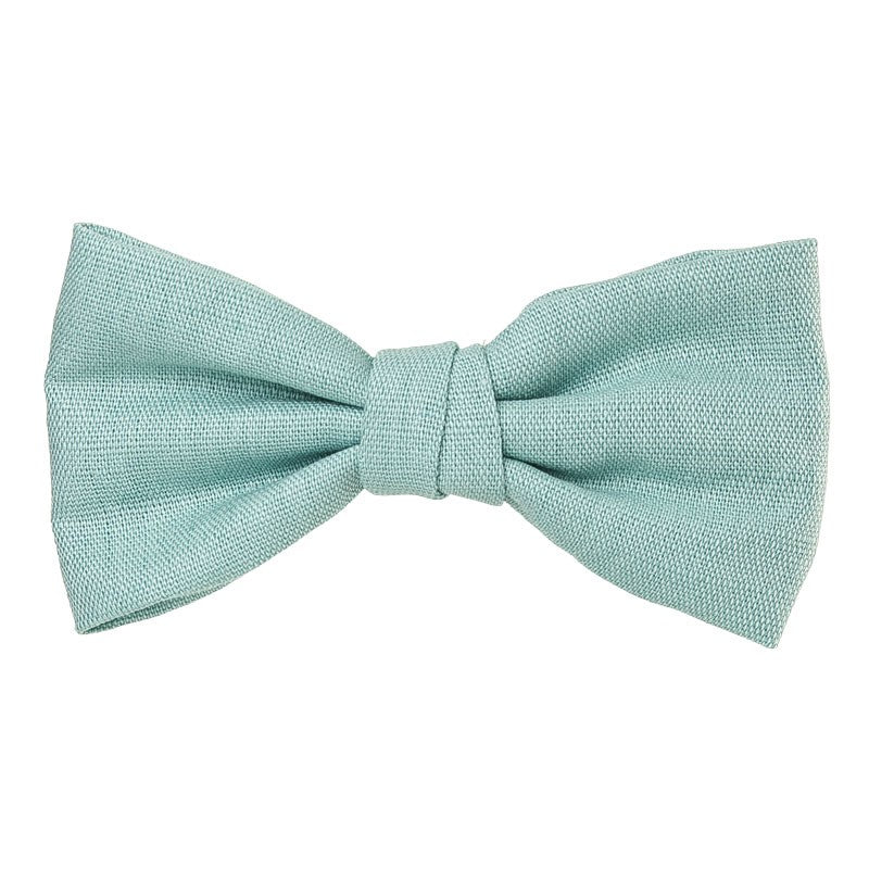 Beautiful and classic Linen bow in an alligator hair clip. This bow adds a perfect touch to any outfit! Timeless design a must have! Handmade in Spain. Olivia Ann Wholesale Accessories.