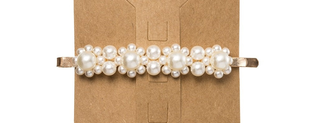 Floral faux pearl embellished hair clip, featuring faux pearl embellishments creating floral silhouettes.This trending Pearl Hair Clip