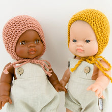 This cosy bonnet is hand knitted in Europe, specially designed for the 34 cm dolls, but can fit dolls around 32 - 38 cm (12 - 15 inch) Miniland, Minikane, Paola Reina Gordis and similar.