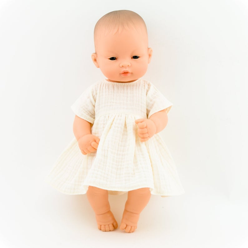 Make your little one's day with this divine doll's ecru muslin dress today. Our dolls clothing is super adorable and of amazing quality, will absolutely melt your heart. Doll dress miniland, minikane, paola reina clothes. Olivia Ann doll clothes