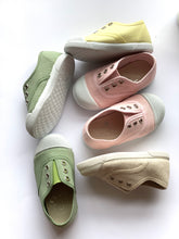 Our OLIVIA ANN soft canvas shoes have a new and improved material that is supersoft and comfortable, and perfect for speedy slip-ons when there's a game in the garden. Plimsoles, sneakers. Kids shoes. Olive. Green