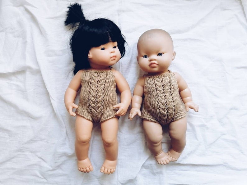 Adorable hand knitted summer romper for dolls in caramel colour with cable pattern at the chest. They will make your children's doll look oh so adorable!  It will fit dolls from 32 up to 38 cm like Miniland, Minikane ,Paola Reina or similar.
