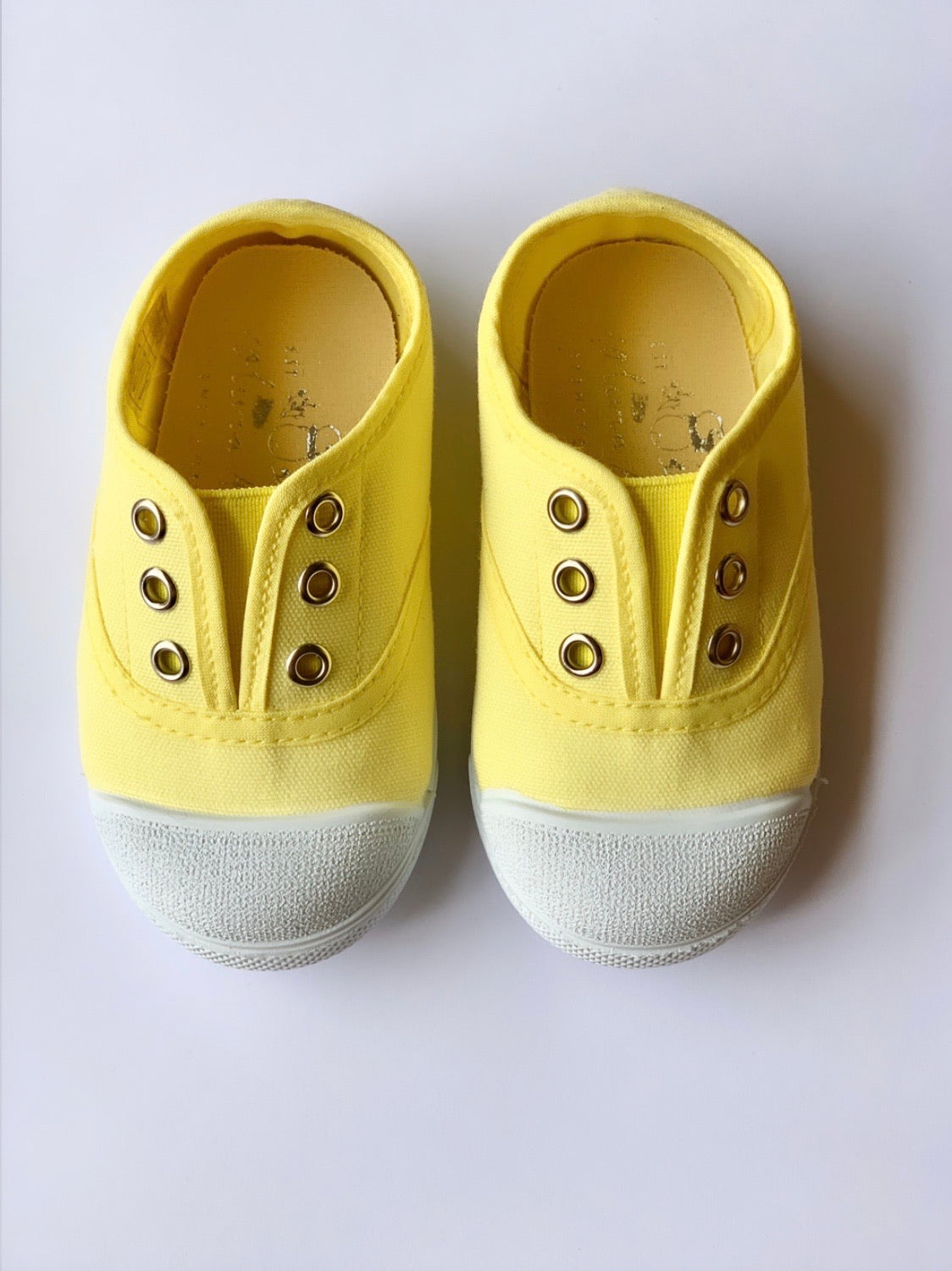 Our OLIVIA ANN soft canvas shoes have a new and improved material that is supersoft and comfortable, and perfect for speedy slip-ons when there's a game in the garden. Plimsoles, sneakers. Kids shoes. Lemon.