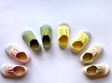 Our OLIVIA ANN soft canvas shoes have a new and improved material that is supersoft and comfortable, and perfect for speedy slip-ons when there's a game in the garden. Plimsoles, sneakers. Kids shoes. Lemon