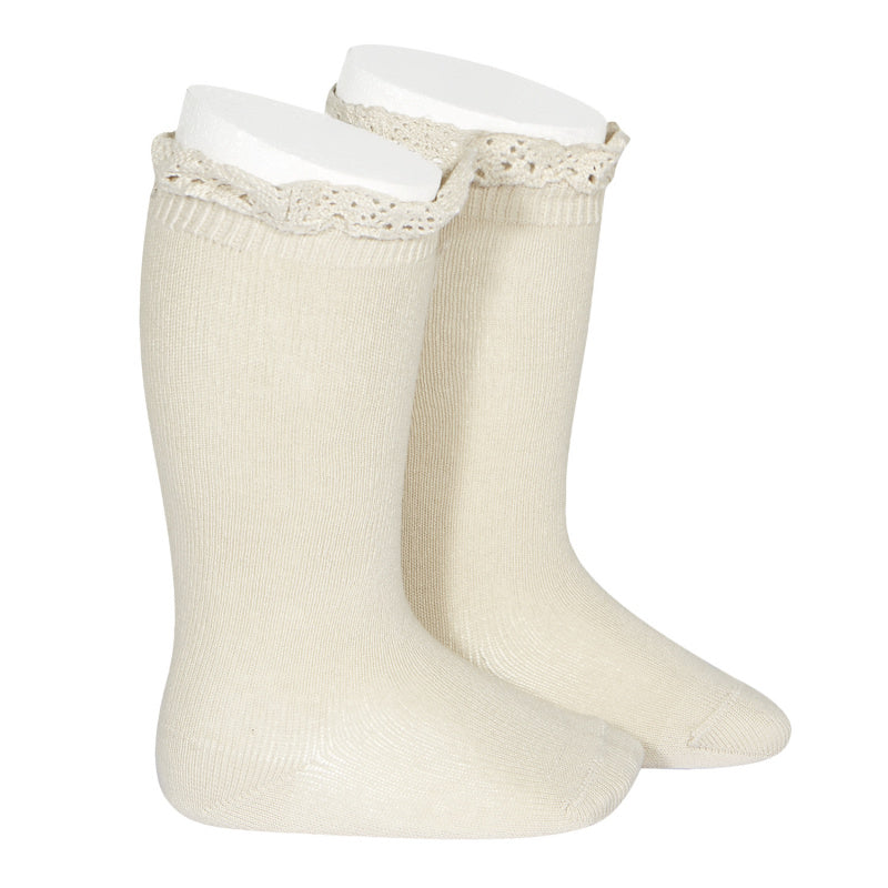 A very special  pair of socks, featuring an beautiful lace edging cuff in a delicate peach colour.  Very good quality socks. Super soft. It will add a beautiful touch to any outfit! Condor socks lace