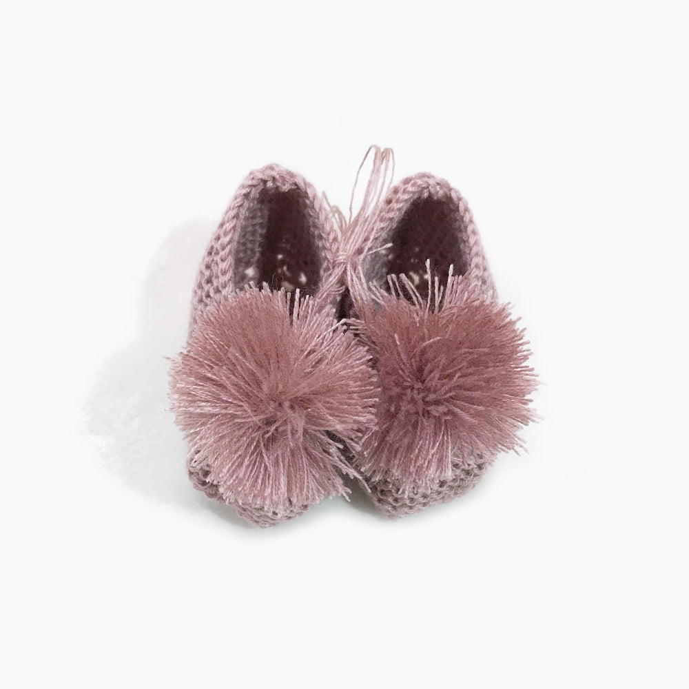 The cutest tiny baby hand knitted shoes.