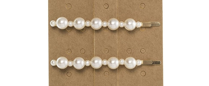 Pack of 2 Hairpins with large and small faux pearls. This trending Pearl Hairpin is the perfect accessory to elevate any outfit!