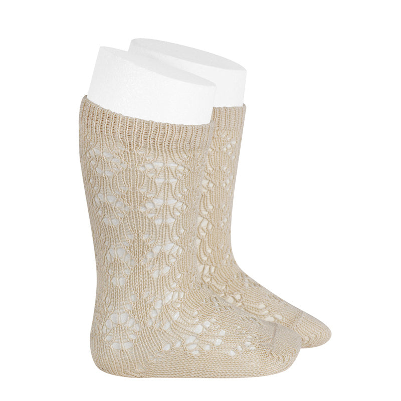 A very special  pair of socks, featuring an exquisite openwork geometric design in a delicate linen colour.  Very good quality socks. Ideal for Spring and Autumn weather. It will add a beautiful touch to any outfit! Soooo sweet. Condor socks stockings
