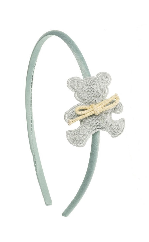 Cutest and unique Teddy Bear hairband. Teddy Bear measures approximately 4 x 4 cm and the hairband 0.5 cm thick. The hairband is handmade with a beautiful and soft grey silk fabric. Wholesale Olivia Ann Accessories