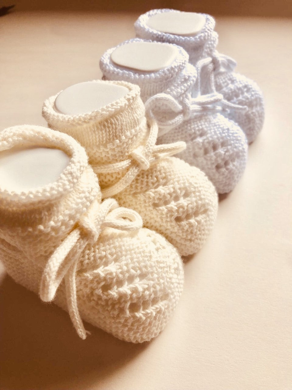 Adorable Unisex Knitted Baby Booties. Available in White and Ecru. Made in Spain with love.
