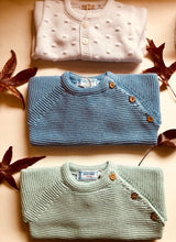 Sweet Unisex knitted Jumper with wooden buttons on the side in an adorable  blue colour. I must have basic piece!