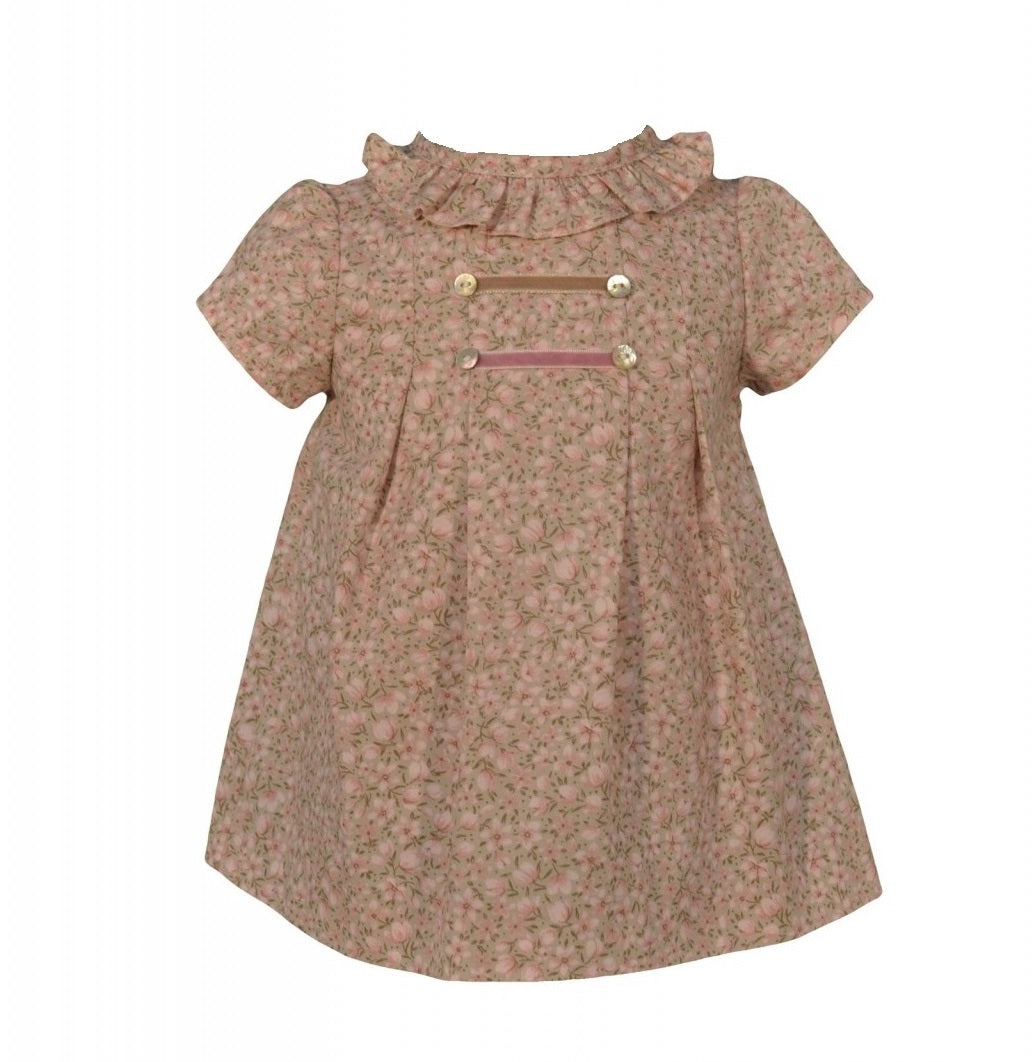 This beautiful dress is made of a beautiful cotton fabric in light pink pattern that resembles tulips. With a sweet round collar, it is also finished off with a delicate frill panel all around the neckline and shoulders.