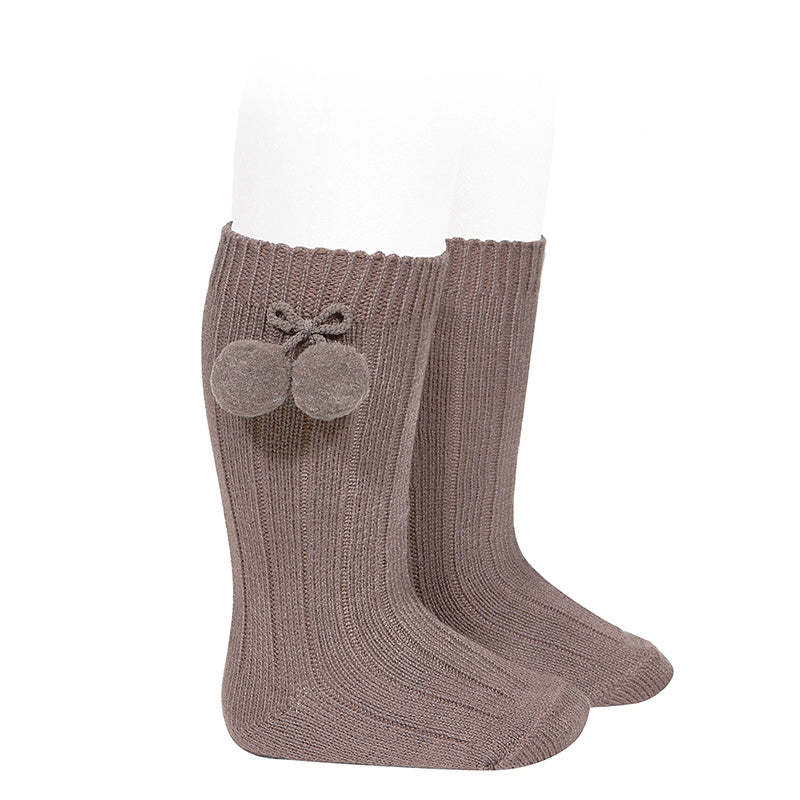 Beautiful and elegant Knee High Ribbed socks with Pom-Poms. An stunning addition to your little one's outfit! Fun and elegant.  praline condor