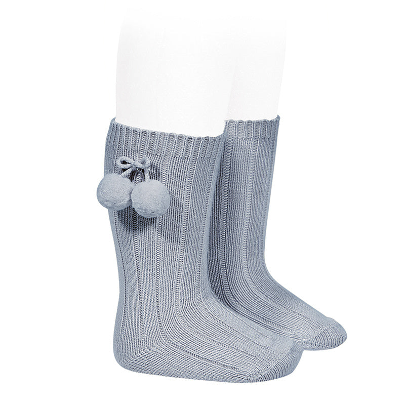 Beautiful and elegant Knee High Ribbed socks with Pom-Poms. An stunning addition to your little one's outfit! Fun and elegant. condor