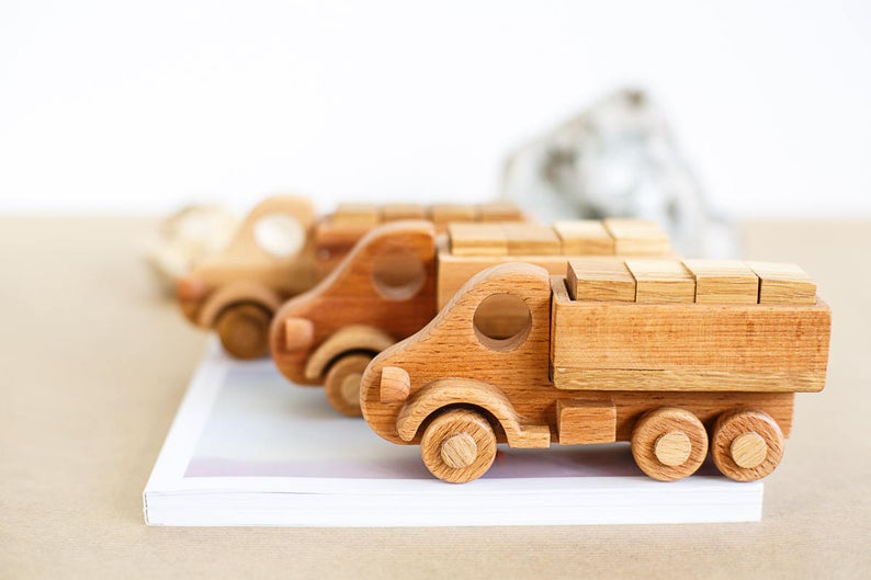 Wooden Car Transporter Toy  with which it is possible to play different role games. The limit is your imagination!  Sustainable and Ethical piece, handmade and designed to stand the test of time, making it the most perfect heirloom toy to pass on to many generations.