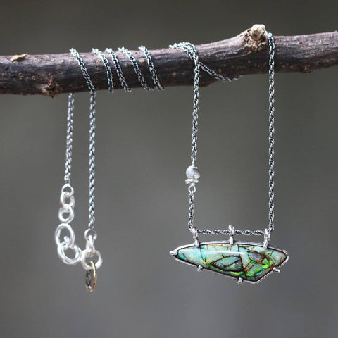 opal pendant necklace in silver braided chain