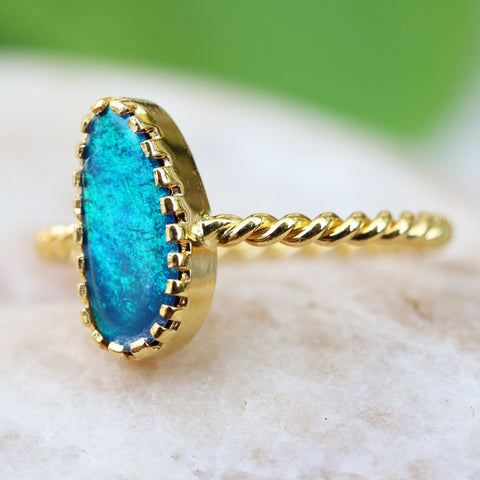 gold ring with blue Australian opal in unique crown setting from Thailand