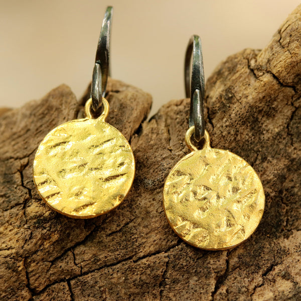 Gold plated brass discs earrings with texture and hangs on sterling silver oxidized hook