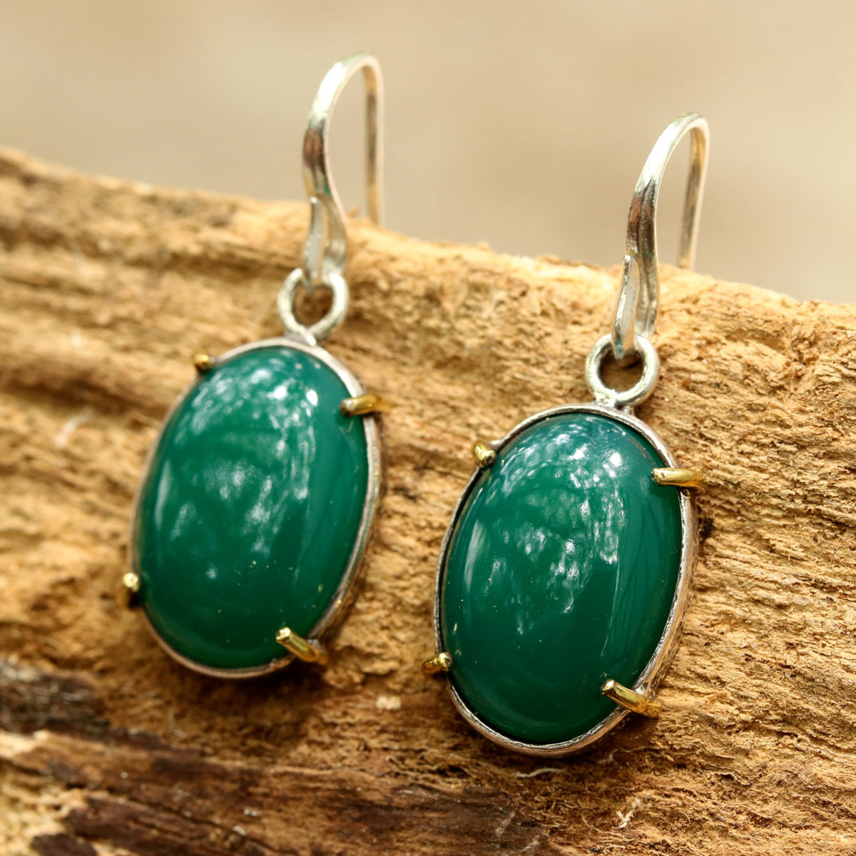 Green onyx cabochon earrings in silver bezel setting with polished brass accent prongs