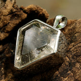 Rutilated quartz  in shield faceted pendant in silver bezel setting with polished silver accent prongs - Metal Studio Jewelry