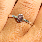 Sterling silver flat texture band ring with oval multi brown star sapphire in silver bezel setting