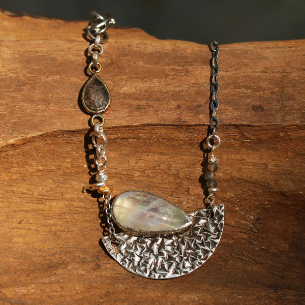 Moonstone pendant necklace in silver bezel setting and silver textured fan with black rutilated quartz on the side and oxidized silver chain