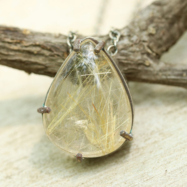 Teardrop rutilated quartz pendant necklace in silver and brass setting with thin link chain/TP