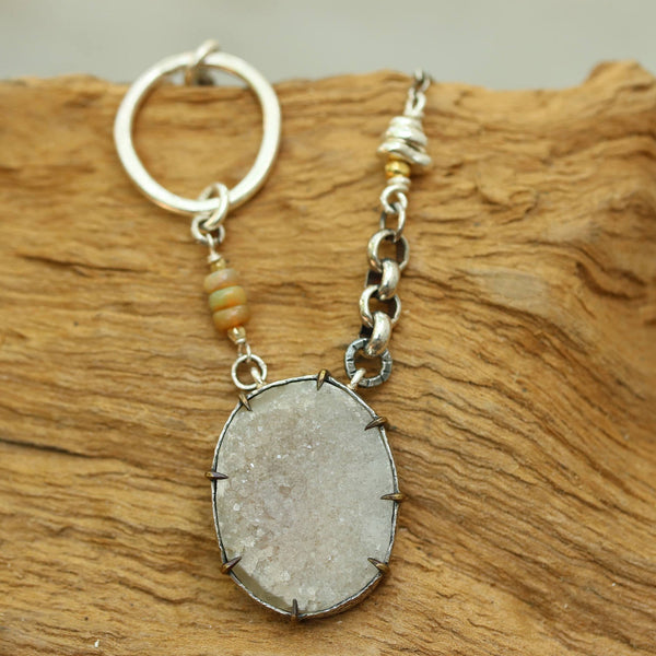 White druzy gemstone pendant necklace in silver bezel and prong setting