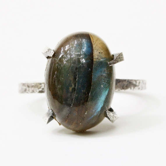 Oval dark blue labradorite ring in silver prongs setting with oxidized texture silver band