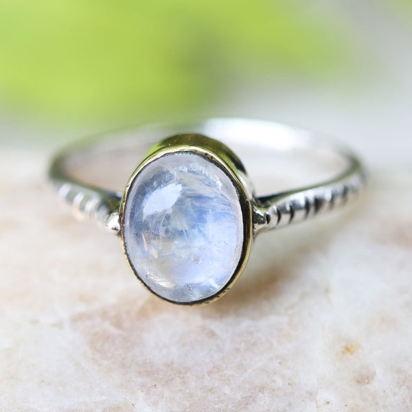 Stunning moonstone cabochon in brass bezel with pinch textured oxidized silver band - Metal Studio Jewelry