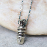 The silver snake in lingam shape pendant necklace with aquamarine on the side and oxidized sterling silver chain - Metal Studio Jewelry