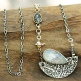 Moonstone pendant necklace in silver bezel setting and silver textured fan with black rutilated quartz on the side and oxidized silver chain - Metal Studio Jewelry