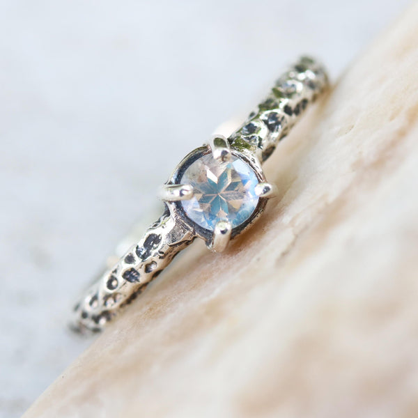 Tiny round moonstone ring in silver prongs setting with sterling silver hard texture oxidized band - Metal Studio Jewelry