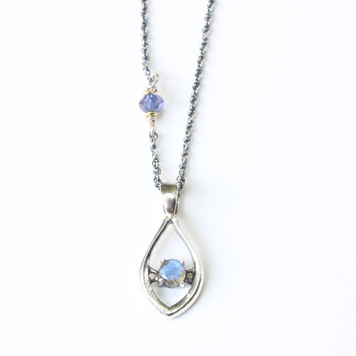 Silver leaf shape necklace and labradorite at the center with iolite beads secondary on oxidized sterling silver chain
