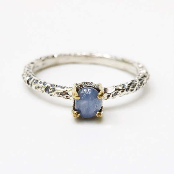 Sterling silver textue ring with blue sapphire in silver bezel with brass prongs setting - Metal Studio Jewelry